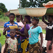 As part of the HCT programme in rural Makurdi EVA staff hand out their flyer advocating their My QandA service. My QandA is mobile phone text service run by EVA where young people can ask questions about sexual health anonymously. Benue state has got one of the highest HIV prevalence in Nigeria and EVA aim to target vulnerable children who would otherwise miss out of being tested for HIV and therefor not know their HIV statues.  Education As a Vaccine Against Aids (EVA) in Nigeria.Education As a Vaccine Against Aids (EVA) in Nigeria. Aids (EVA) in Nigeria.