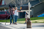A film crew interviewing neighbors of Markus Kaarma and Diren Dede in the Grant Creek neighborhood of Missoula, Montana. Kaarma is accused of shooting and killing Diren Dede, a German exchange student in his garage on April 27, 2014.