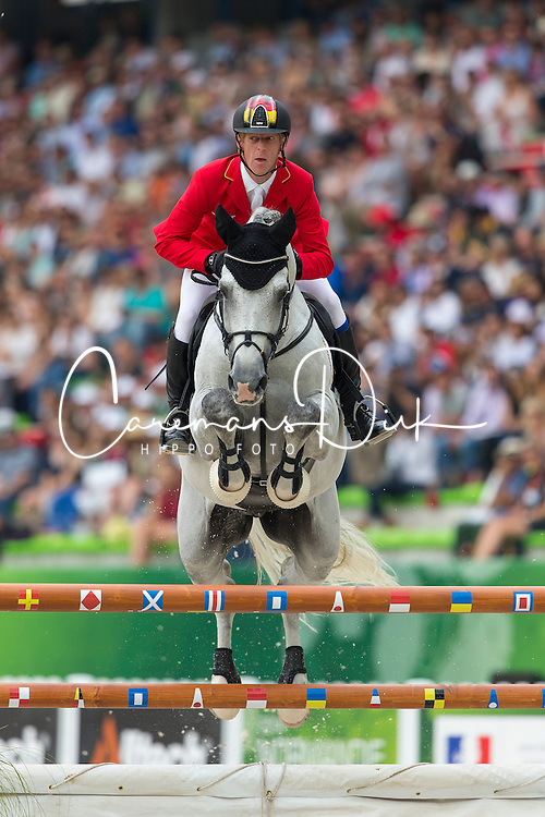 Marcus Ehning, (GER), Cornado NRW - World Champions, - Second Round Team Competition - Alltech FEI World Equestrian Games&trade; 2014 - Normandy, France.<br /> &copy; Hippo Foto Team - Leanjo De Koster<br /> 25/06/14