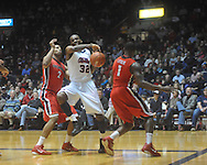 """Ole Miss guard Zach Graham (32)  is defended by Georgia's Marcus Thornton (2) and Georgia's Travis Leslie (1) at the C.M. """"Tad"""" Smith Coliseum in Oxford, Miss. on Saturday, January 15, 2011. Georgia won 98-76.  (AP Photo/Oxford Eagle, Bruce Newman)"""
