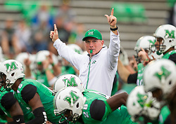 Oct 24, 2015; Huntington, WV, USA; Marshall Thundering Herd head coach Doc Holliday coaches his team during warmups before the game against the North Texas Mean Green at Joan C. Edwards Stadium. Mandatory Credit: Ben Queen-USA TODAY Sports