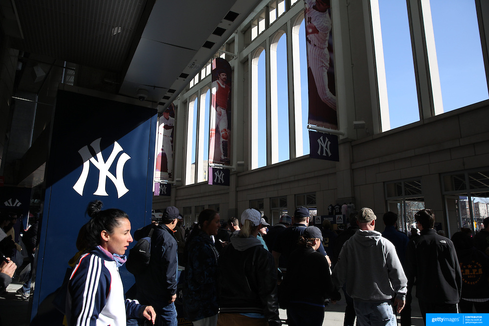 Fans leave the stadium at the end of the game during the New York Yankees Vs Toronto Blue Jays season opening day at Yankee Stadium, The Bronx, New York. 6th April 2015. Photo Tim Clayton