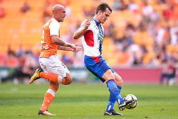 October 22, 2017 - Brisbane, QUEENSLAND, AUSTRALIA - Nigel Boogaard of the Jets (#4, right) passes the ball under pressure from Massimo Maccarone of the Roar (#9) during the round three Hyundai A-League match between the Brisbane Roar and the Newcastle Jets at Suncorp Stadium on October 22, 2017 in Brisbane, Australia. (Credit Image: © Albert Perez via ZUMA Wire)