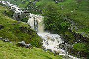 Greenup Gill stream flows high with heavy rain. On England Coast to Coast hike with Wilderness Travel, day 4 of 14, we hiked from Rosthwaite to Grasmere, in Lake District National Park, United Kingdom, Europe. We climbed to Lining Crag and descended via Easdale to Grasmere. Overnight at Keswick Country House, in Cumbria county. [This image, commissioned by Wilderness Travel, is not available to any other agency providing group travel in the UK, but may otherwise be licensable from Tom Dempsey – please inquire at PhotoSeek.com.]