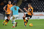 Hull City midfielder Shaun Maloney flicks ball clear of Derby County's Jeff Hendrick during the Sky Bet Championship match between Hull City and Derby County at the KC Stadium, Kingston upon Hull, England on 27 November 2015. Photo by Ian Lyall.