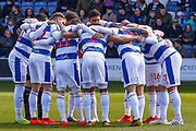 Queens Park Rangers players huddle before the the EFL Sky Bet Championship match between Queens Park Rangers and Swansea City at the Loftus Road Stadium, London, England on 13 April 2019.