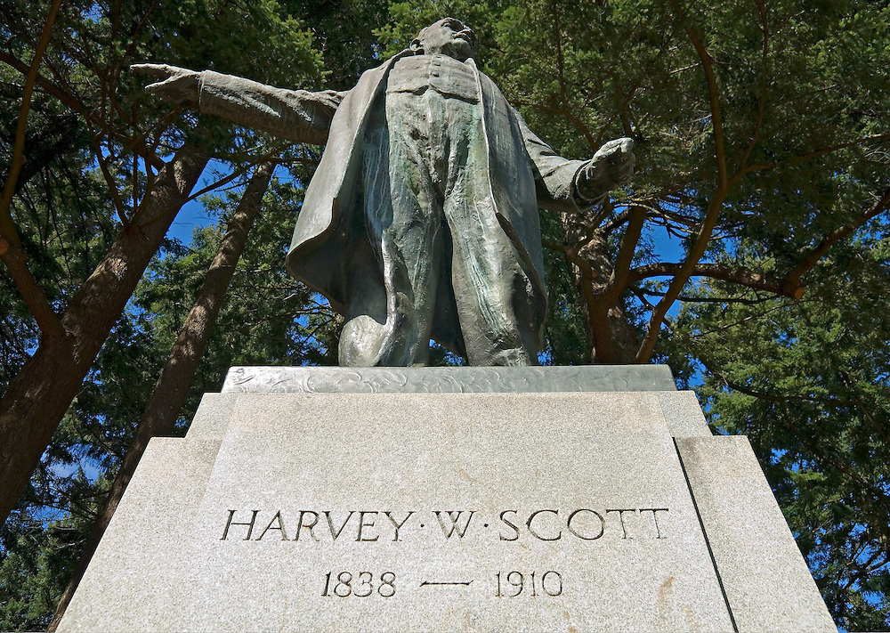 """Statue in Mt Tabor Park of Harvey W. Scott, 1838-1910.  Inscription states: """"Pioneer, Editor, Publisher and molder of public opinion in Oregon and the nation.""""  He was editor of the The Oregonian newspaper from 1866-1872."""