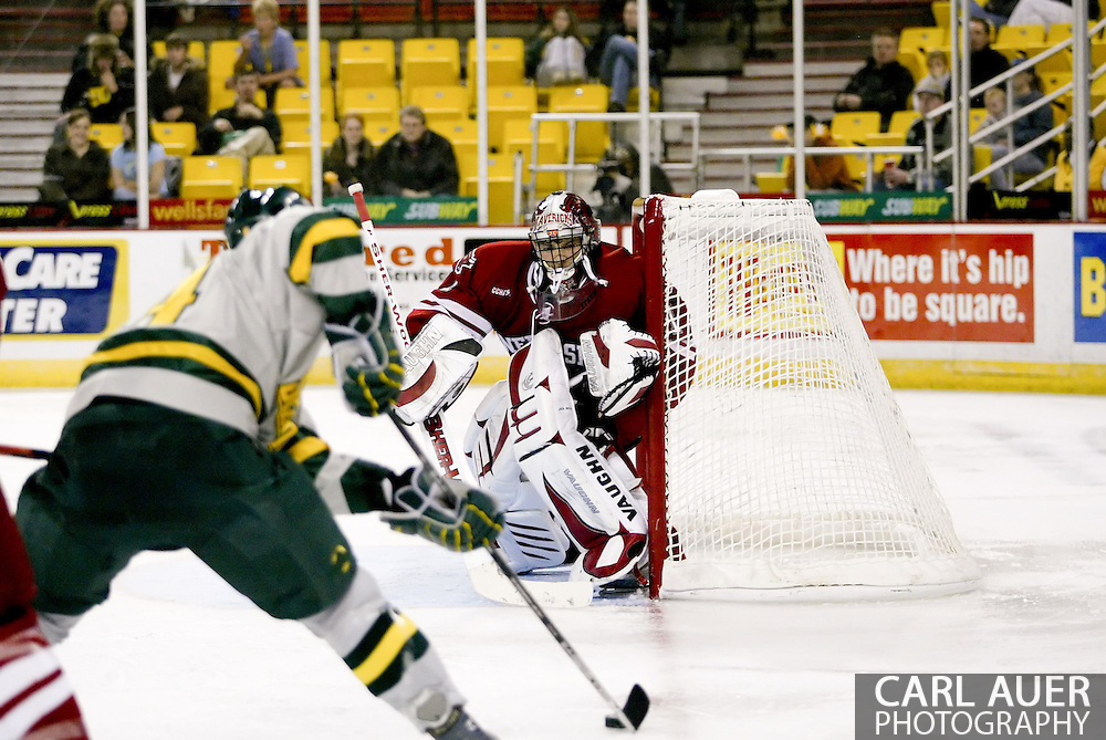 10/13/2006 - Anchorage, Alaska: Jeremie DuPont (1) of the Nebraska-Omaha Mavericks sets up to stop a shot from Merit Waldrop (14) of the Alaska-Anchorage Seawolves in the final game of the Nye Frontier Classic