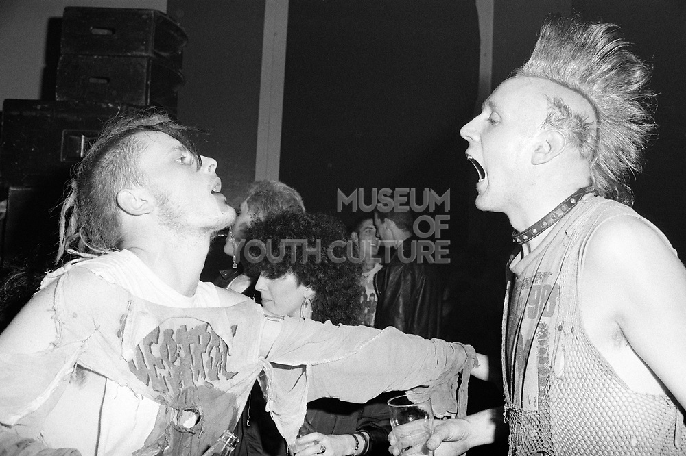 Two punks moshing, Angelic Upstarts gig, Camden 1987