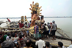 October 7, 2018 - Kolkata, West Bengal, India - Labors load Idol of Goddess Durga to boat for transportation ahead of Durga Puja festival. Idols of Goddess Durga transported on boats through the water of River Ganges to pandal or temporary platform ahead of Durga Puja festival. (Credit Image: © Saikat Paul/Pacific Press via ZUMA Wire)
