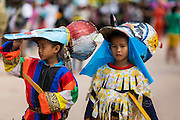 28 JUNE 2014 - DAN SAI, LOEI, THAILAND: Boys dressed as ghosts at the Ghost Festival in Dan Sai. Phi Ta Khon (also spelled Pee Ta Khon) is the Ghost Festival. Over three days, the town's residents invite protection from Phra U-pakut, the spirit that lives in the Mun River, which runs through Dan Sai. People in the town and surrounding villages wear costumes made of patchwork and ornate masks and are thought be ghosts who were awoken from the dead when Vessantra Jataka (one of the Buddhas) came out of the forest.    PHOTO BY JACK KURTZ