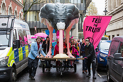 London, UK. 6 December, 2019. Climate change activists from Extinction Rebellion bring a 4-metre tall ostrich to an 'Operation Big Bird' dance party outside the Conservative party headquarters as part of a series of 'Election Rebellion' protests intended to apply pressure on political parties to place the climate and ecological emergency at the centre of their general election campaigning.