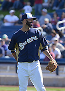PHOENIX, AZ - FEBRUARY 23:  Pitcher Mike Fiers #64 of the Milwaukee Brewers reacts on the mound in the spring training game against the Oakland Athletics at Maryvale Baseball Park on February 23, 2013 in Phoenix, Arizona.  (Photo by Jennifer Stewart/Getty Images) *** Local Caption *** Mike Fiers