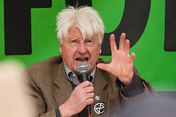 """London, UK. 9 October, 2019. Stanley Johnson, father of Prime Minister Boris Johnson, addresses climate activists from Extinction Rebellion in Trafalgar Square on the third day of International Rebellion protests. He commented that the Prime Minister's characterisation of the protesters as """"uncooperative crusties"""" had been made in jest and described their work as """"extremely important""""."""