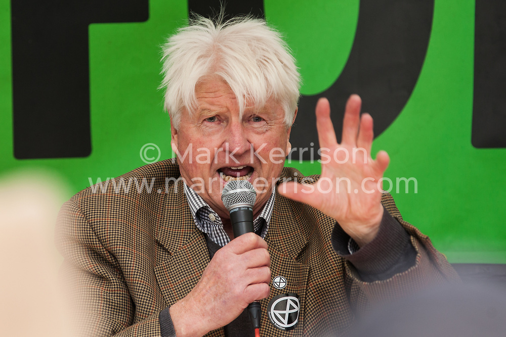 "London, UK. 9 October, 2019. Stanley Johnson, father of Prime Minister Boris Johnson, addresses climate activists from Extinction Rebellion in Trafalgar Square on the third day of International Rebellion protests. He commented that the Prime Minister's characterisation of the protesters as ""uncooperative crusties"" had been made in jest and described their work as ""extremely important""."