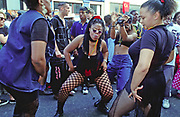 Girls dancing together, Notting Hill Carnival, UK, 2000's