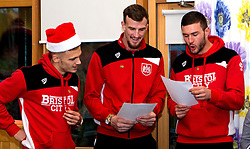 Jamie Paterson, Aden Flint and Richard O'Donnell of Bristol City sing christmas carols duringBristol City's visit to the Children's Hospice South West at Charlton Farm - Mandatory by-line: Robbie Stephenson/JMP - 21/12/2016 - FOOTBALL - Children's Hospice South West - Bristol , England - Bristol City Children's Hospice Visit