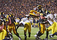 October 10, 2009: Iowa running back Brandon Wegher (3) scores on a 3 yrd touchdown run during the first half of the Iowa Hawkeyes' 30-28 win over the Michigan Wolverine's at Kinnick Stadium in Iowa City, Iowa on October 10, 2009.