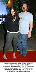 Musician ALEX JAMES and his wife at a party in London on 9th June 2004.PUZ 180