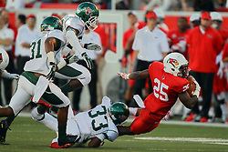 06 Sep 2014: Mark Pegues grabs the legs of Marshaun Coprich as he is rounding the end of the line and getting into the flats during a non-conference NCAA football game between the Delta Devils of Mississippi Valley State and the Redbirds of Illinois State at Hancock Stadium in Normal Il