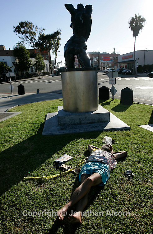 A homeless man sleeps on Windward Circle next to the late Venice Beach artsit Robert Graham's  Venice Torso.  For years, the Venice area has attracted people with nothing left but their cars or recreational vehicles - and the belongings they can fit inside. The city of Los Angeles is developing a program to help people in that situation. It would accompany new parking restrictions designed to reduce the number of sleep-in vehicles that stay overnight on residential streets. Many residents who occupy houses, apartments and businesses in Venice complain about the hygiene challenges homeless people face. Access to restrooms, showers, and trash But lately, tensions have been rising between homeowners and the homeless, who live in their cars, campers and RVs.Some say Venice has become an urban RV park. Access to restrooms, showers, and trash facilities are some of the amenities the city of Los Angeles would like to offer people who sleep in their cars in Venice. The program in development would provide safe overnight parking spots in the lots of say, churches, nonprofits, or business parks. It also would connect the people who park there with social services and case management.