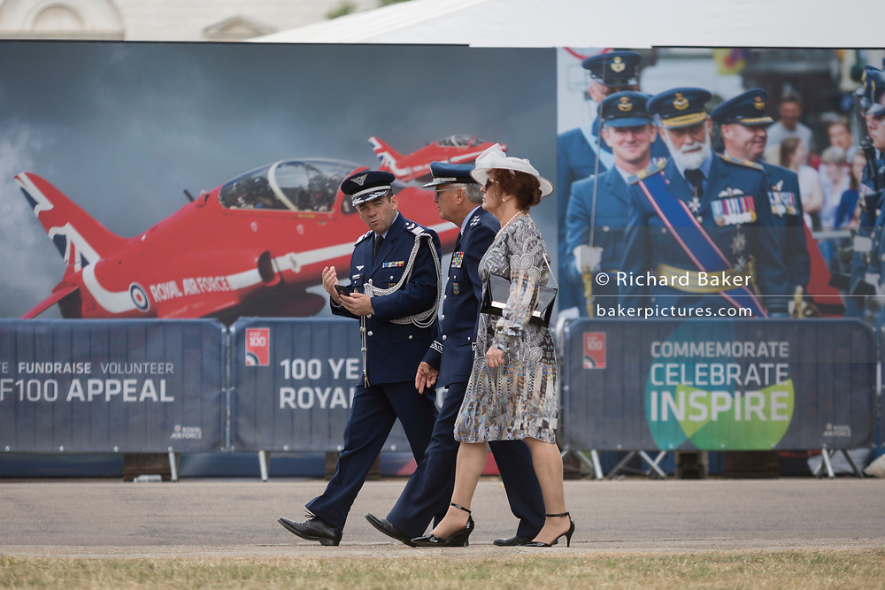 On the 100th anniversary of the Royal Air Force (RAF) and after a march andflypast of 100 aircraft formations representing Britain's air defence history which flew over central London, foreign service oficers walk past an RAF recruiting hoarding, on 10th July 2018, in London, England.