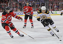 Apr 10; Newark, NJ, USA; Boston Bruins left wing Milan Lucic (17) skates with the puck while being defended by New Jersey Devils defenseman Anssi Salmela (29) during the first period of their game at the Prudential Center.