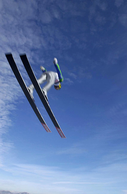In a blur of speed a ski jumper goes of the end of the 120 meter jump during World Cup competition at Park City's Olympic winter ski Park.  Photo taken Friday Jan. 19, 2001. photo by August Miller