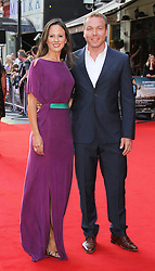 Licensed to London News Pictures. Chris Hoy and wife Sarra Kemp, Alan Partridge: Alpha Papa World Film Premiere, Vue West End cinema Leicester Square, London UK, 24 July 2013. Photo credit: Richard Goldschmidt/LNP