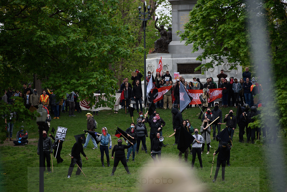 Members of North Shore Antifa (short for antifacist), among others, gather at Boston Common to protest a rally by factions of the alt-right, May 13, 2017.<br /> Photo / Kate Flock