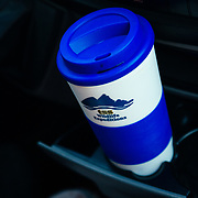 A coffee mug on the dash of a Teten Science Schools van during a spring wildlife tour.