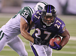 Sept 13, 2011; East Rutherford, NJ, USA; New York Jets safety Eric Smith (33) tackles Baltimore Ravens running back Ray Rice (27) during the second half at the New Meadowlands Stadium.  The Ravens defeated the Jets 10-9.