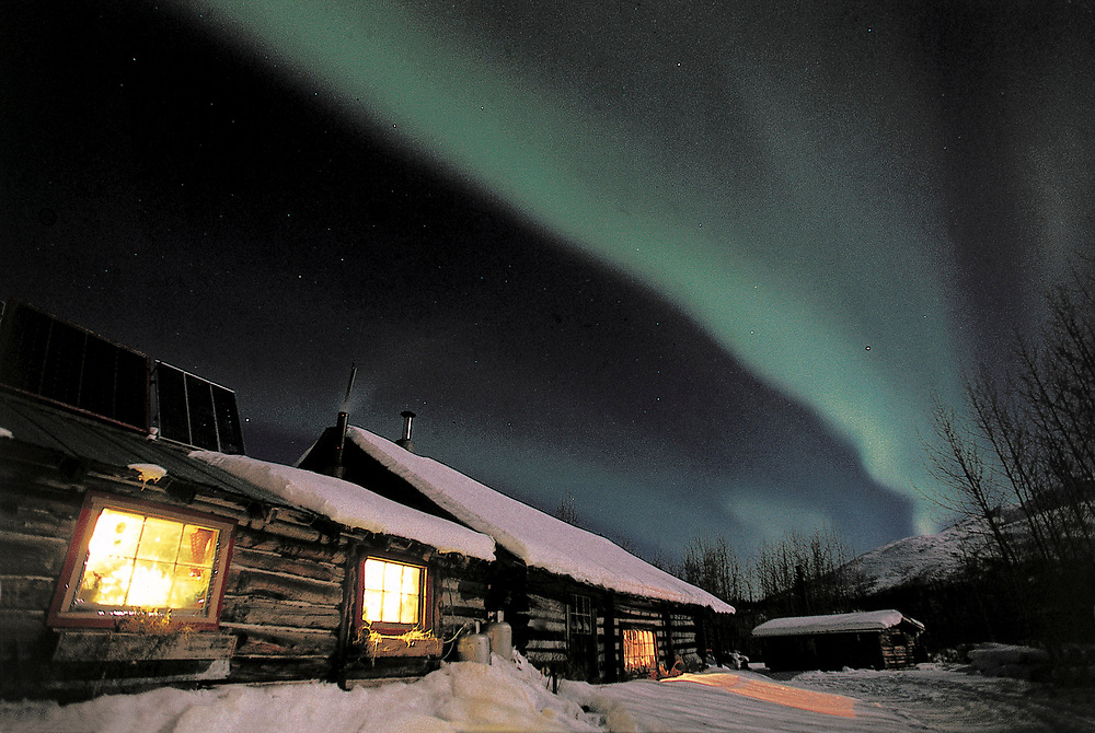 Alaska. Wiseman. Aurora Borealis over a Brooks Range Bed and Breakfast.