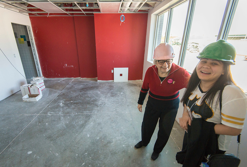 Bertie Simmons checks out progress on her new office during a Project Advisory Team tour of construction at Furr High School, April 6, 2017.
