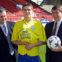 St Johnstone new strip...03.05.01<br /> Ross Forsyth models the new strip flanked by Ray Smethurst of Scottish Hydro Electric and Chairman Geoff Brown<br /> <br /> see story by Gordon Bannerman Tel: 01738 553978<br /> <br /> Pic by Graeme Hart<br /> Copyright Perthshire Picture Agency<br /> Tel: 01738 623350 / 07990 594431