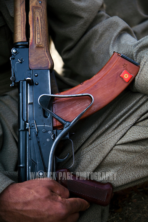 QANDIL MOUNTAINS, IRAQI KURDISTAN - SEPTEMBER 19: A PKK (Kurdish Worker's Party) flag is seen on the magazine of his assault rifle, during training exercises, on September 19, 2010, in the Qandil Mountains, Iraqi Kurdistan. Labelled as terrorists by the Turkish, US and EU, it's in the Qandil Mountains near the border where the guerrillas of the PKK live and wage their 26 year war against Turkey that has claimed over 40,000 lives. (Photo by Warrick Page)