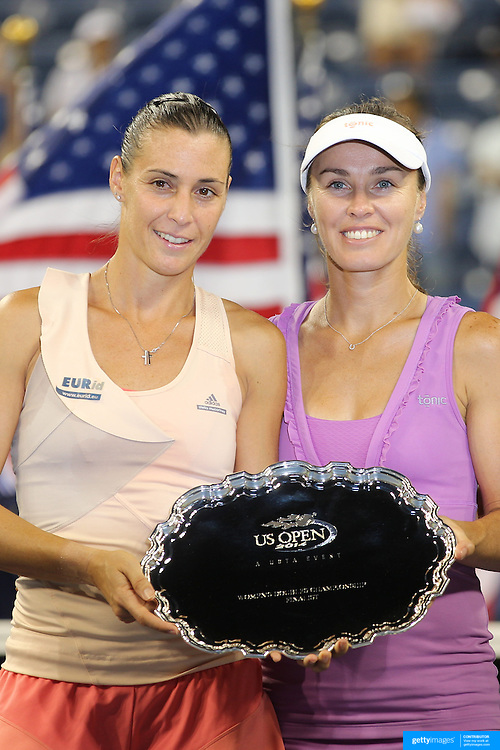Martina Hingis, Switzerland,  with her doubles partner Flavia Pennetta, Italy, after the Women's Doubles Final which the pair lost to  Ekaterina Makarova and Elena Vesnina, Russia, during the US Open Tennis Tournament, Flushing, New York, USA. 6th September 2014. Photo Tim Clayton