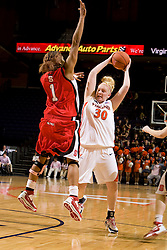 N.C. State forward Khadijah Whittington (1) guards Virginia forward/center Abby Robertson (30).  The Virginia Cavaliers defeated the NC State Wolfpack women's basketball team 74-49 at the John Paul Jones Arena in Charlottesville, VA on February 1, 2008.
