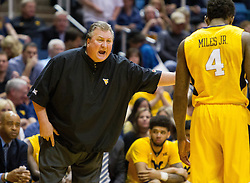 Feb 18, 2017; Morgantown, WV, USA; West Virginia Mountaineers head coach Bob Huggins yells at West Virginia Mountaineers guard Daxter Miles Jr. (4) during the first half against the Texas Tech Red Raiders at WVU Coliseum. Mandatory Credit: Ben Queen-USA TODAY Sports
