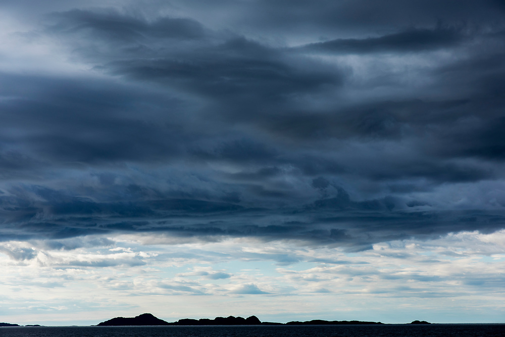 Canada, Labrador, Makkovik, Storm clouds over offshore islands along Labrador Coast on summer afternoon