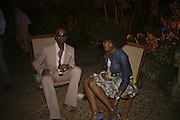 Saheed and Vanessa Sulaiman. Quintessentially Summer party, Debenham House. Addison Rd. London. 15 June 2006. ONE TIME USE ONLY - DO NOT ARCHIVE  © Copyright Photograph by Dafydd Jones 66 Stockwell Park Rd. London SW9 0DA Tel 020 7733 0108 www.dafjones.com