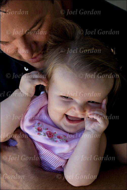 Portrait of father playing with his 8 month old daughter .. release #2459