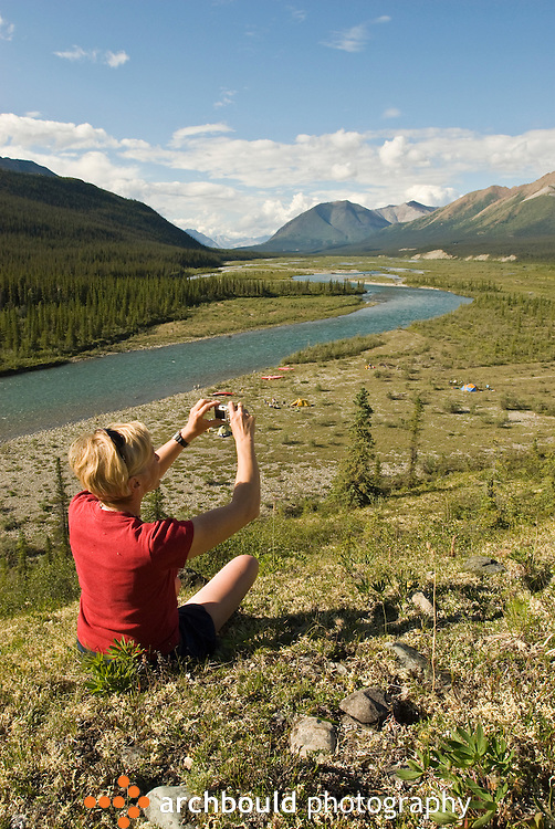 A canoeist takes a photograph of her Wind River campsite, Yukon.<br /> <br /> NOT IN YOUR BUDGET? Contact Cathie for a price specific to your project.