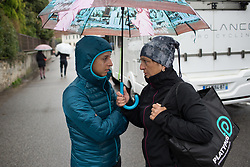 Rossella Ratto (ITA) of Cylance Pro Cycling finds refuge from the rain before the Trofeo Alfredo Binda - a 131,1 km road race, between Taino and Cittiglio on March 18, 2018, in Varese, Italy. (Photo by Balint Hamvas/Velofocus.com)