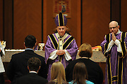 Chicago Archbishop Francis Cardinal George prepares to receive the gifts of a  mass at Holy Name Cathedral to promote service in the church for high school students from the Chicago Archdiocese and the diocese of Rockford and Joliet.