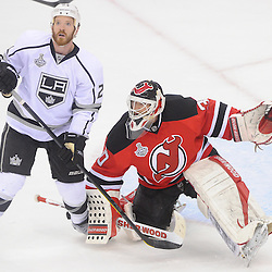 June 9, 2012: Los Angeles Kings center Colin Fraser (24) watches the puck deflect away from New Jersey Devils goalie Martin Brodeur (30) during first period action in game 5 of the NHL Stanley Cup Final between the New Jersey Devils and the Los Angeles Kings at the Prudential Center in Newark, N.J.