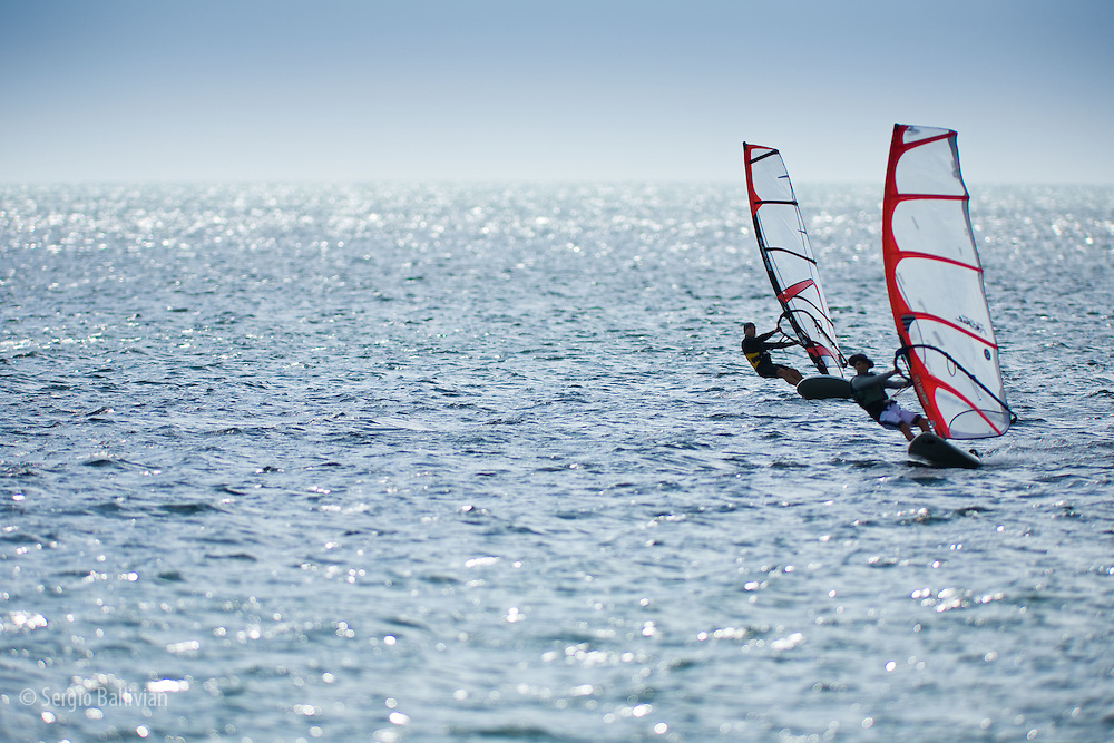 Windsurfers enjoy warm breezes in Key Biscayne near Miami, Florida.