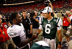 Sept 3, 2009; East Rutherford, NJ, USA;  Philadelphia Eagles quarterback Michael Vick (7) and New York Jets quarterback Mark Sanchez (6) shake hands after their game at Giants Stadium.  The Jets defeated the Eagles 38-27.