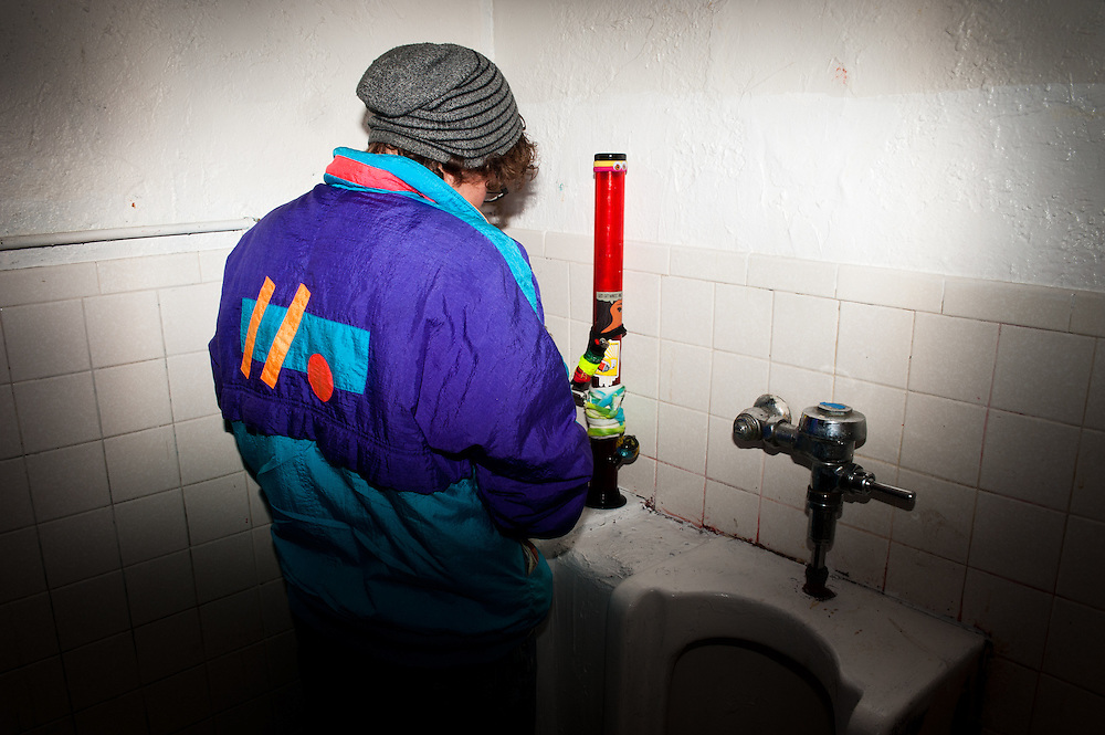 Westley English sets his bong on a urinal and takes a break at a medical marijuana patients' meetup in Denver, Colorado on Feb. 24, 2013. Organized clubs and events, where it is legal for marijuana patients to smoke and exchange medicine, began appearing in Colorado in 2013.