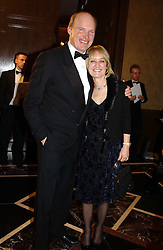 MR & MRS JOHN GOSDEN at the 2004 Cartier Racing Awards in association with the Daily Telegraph, held at the Four Seasons Hotel, London on 17th November 2004.<br />